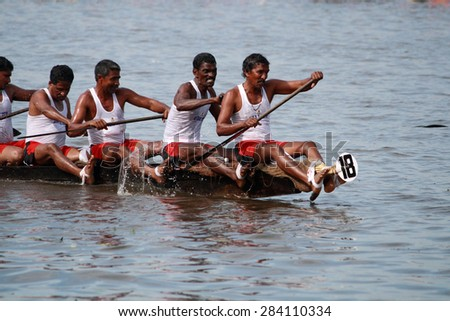 ALLEPPEY, INDIA - AUG 14 : A snake boat team participates in Nehru Trophy Boat race on August 14, 2010 in Alleppey, India.Nehru Trophy Boat race is very popular and competitive race event of Kerala.
