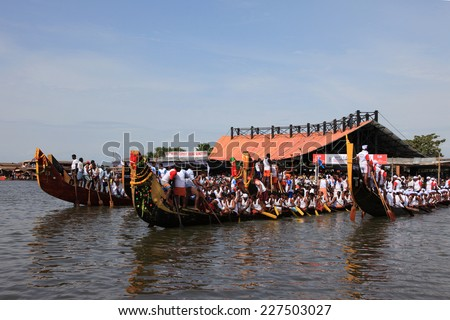 ALLEPPEY, INDIA - AUG 09 : Snake boat teams participate in the most popular Nehru Trophy Boat race held in August 09, 2014 in Alleppey,Kerala, India.
