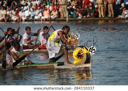 ALLEPPEY, INDIA - AUG 14 :Snake boat teams participate in the Nehru Trophy Boat race on August 14, 2010 in Alleppey, India.Nehru Trophy Boat race is very popular and competitive race event of Kerala.
