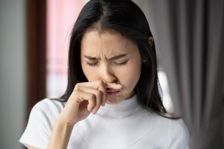 allergic sick woman or girl with runny nose, flu or covid-19 symptom, health care concept