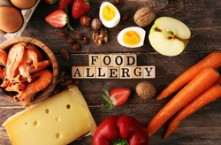 Allergy food concept. Allergy food as almonds, milk, cheese, strawberry, seeds, eggs, peanuts and 