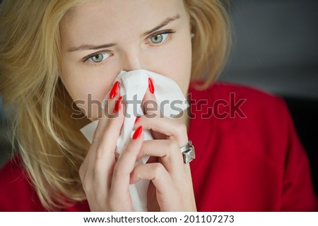 Allergy or cold flu illness tissue blowing runny nose
