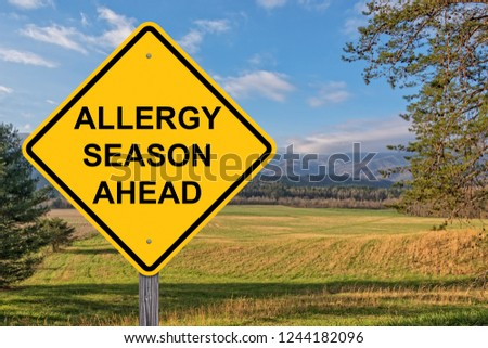Allergy Season Ahead Caution Sign With Springtime Background #1244182096