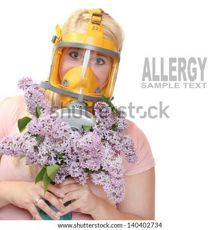 Allergy to pollen concept. Young woman in protection mask with bunch of flower.
