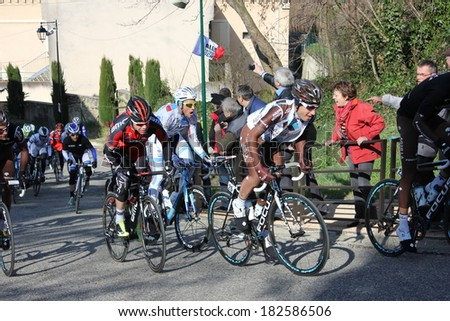 ALLEX, FRANCE - MAR 02: Axel Domont and Cadel Evans, former world champion, riding La Classic Drome UCI Europe Tour on March 02, 2014 in Allex Hill, Drome, France. Romain Bardet won the race.