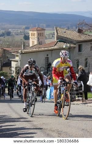 ALLEX, FRANCE - MAR 02: Sebastien Delfosse and Axel Domont riding La Classic Drome UCI Europe Tour Pro Race on March 02, 2014 in Allex Hill, Drome, France. Romain Bardet won the race.
