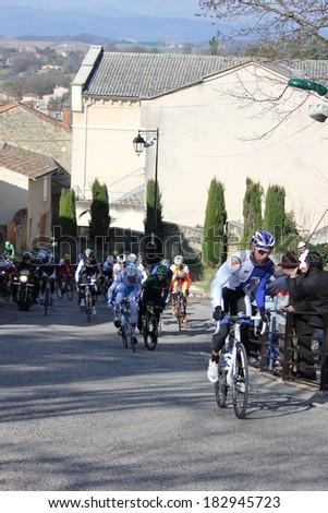 ALLEX, FRANCE - MAR 02: Unidentified professional cyclist riding La Classic Drome UCI Europe Tour Pro Race on March 02, 2014 in Allex Hill, Drome, France. Romain Bardet won the race. - stock photo