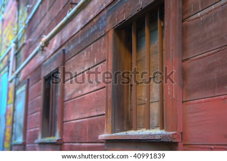 Alley in Locke California with barred and boarded up windows
