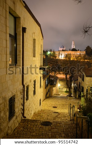 Alley in Mishkenot Sha'ananim, the first Jewish neighborhood outside of the Old City, looking towards the Dormition Monastery in Jerusalem, Israel.