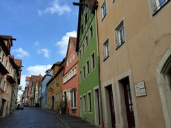 Alley of Rothenburg ob der tauber city in germany. Small stone street. Colorful old buildings of rothenburg. Medieval buildings.