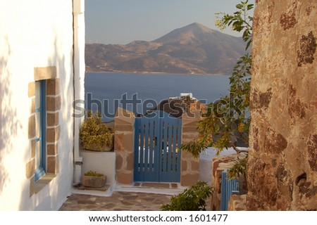 alley with a view to a chapel in the distance at an island in Greece