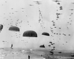 Allied aircraft drop paratroopers into German held Netherlands, for Operation Market Garden. The plan to capture key bridges in Netherlands failed with 15,000 Allied casualties.
