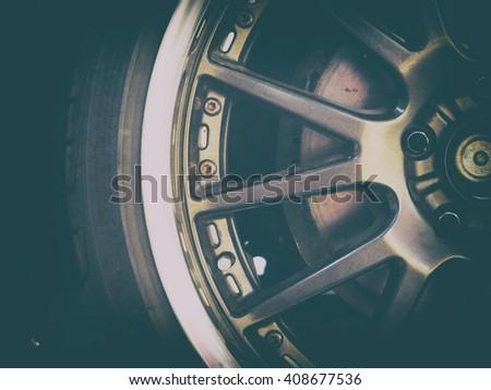 Alloy Car Wheel Closeup. Modern Car Wheel. vintage color