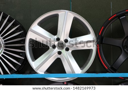 Alloy Wheel of car on the shelf. Alloy wheels are wheels that are made from an alloy of aluminium or magnesium. Alloys are mixtures of a metal and other elements.