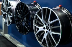 Alloy wheels are displayed in the shop.