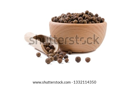 allspice  in wooden bowl and scoop isolated on white background. Spices and food ingredients. #1332114350