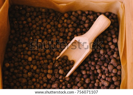 Allspice pepper berries on from above. Dried allspice in measuring spoon. Spices & seasonings #756071107
