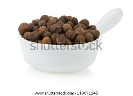 allspice spices in bowl isolated on white background