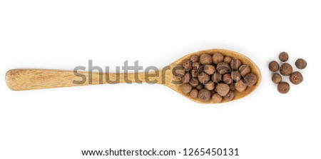 Allspices or Jamaica pepper in wooden spoon isolated on white background. Top view #1265450131