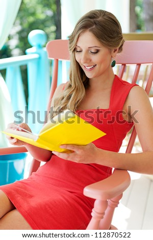 alluring smiley woman reading the book