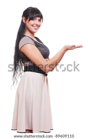 alluring woman presenting something on open hand palm. isolated on white background
