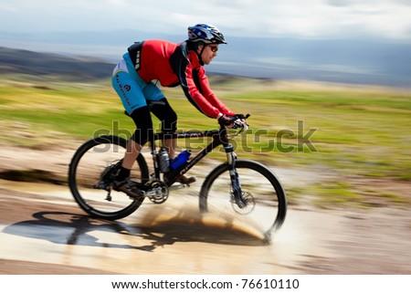 "ALMATY, KAZAKHSTAN - APRIL 30: A.Kaspersky (N6) in action at Adventure mountain bike cross-country marathon in mountains ""Jeyran Trophy 2011"" April 30, 2011 in Almaty, Kazakhstan."
