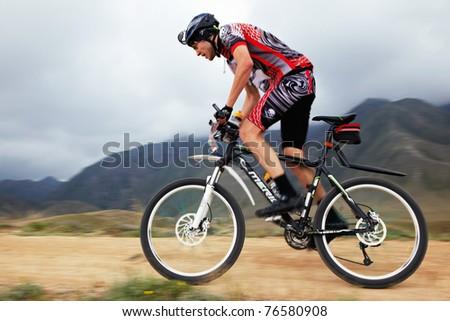 "ALMATY, KAZAKHSTAN - APRIL 30: A.Litvinov (N40) in action at Adventure mountain bike cross-country marathon in mountains ""Jeyran Trophy 2011"" April 30, 2011 in Almaty, Kazakhstan."