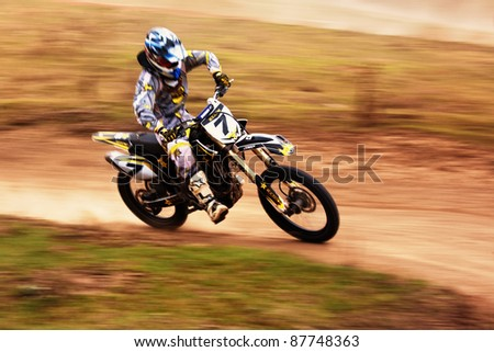 "ALMATY, KAZAKHSTAN - APRIL 10: A.Tindikov (7) participates at Motocross competition ""Fabrichny Cup""- Open Championship of Kazakhstan, on April 10, 2011 in Almaty, Kargaly, Kazakhstan."