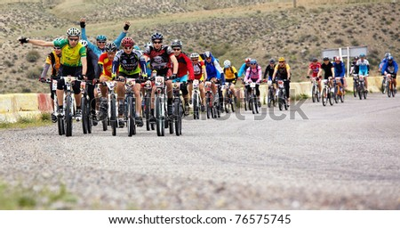 "ALMATY, KAZAKHSTAN - APRIL 30: Athletes compete in the ""Jeyran Trophy 2011"" adventure mountain bike cross-country marathon in mountains on April 30, 2011 in Almaty, Kazakhstan."