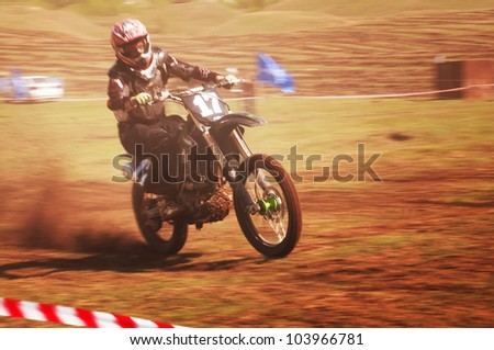 "ALMATY, KAZAKHSTAN - APRIL 22 D.Gavrilenko (N17) at the Motocross competition ""Fabrichny Cup""- Open Championship of Kazakhstan on April 22, 2012 in Almaty, Kazakhstan."