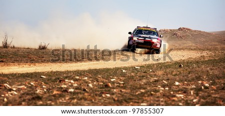"""ALMATY, KAZAKHSTAN - APRIL 9: Danov and Revin (10) in action at auto competition """"Rally Borly"""" on April 9, 2011 in Almaty, Kazakhstan."""