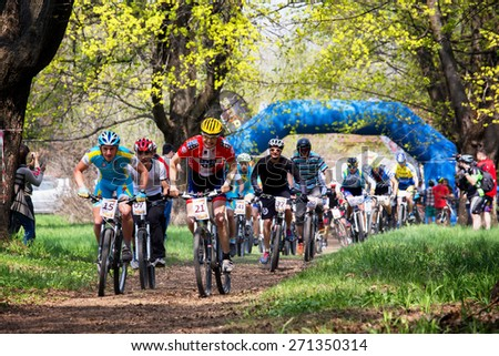 ALMATY, KAZAKHSTAN - APRIL 19, 2015: Group of bikers started in action at cross-country competition \