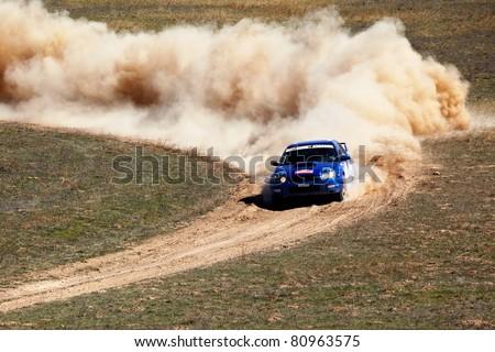 "ALMATY, KAZAKHSTAN - APRIL 9: Ibragimova and Baluk (1) in action at auto competition ""Rally Borly"" on April 9, 2011 in Almaty, Kazakhstan."