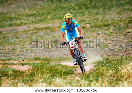 "ALMATY, KAZAKHSTAN - APRIL 29: K.Kazantcev (N2) in action at Adventure mountain bike cross-country marathon in mountains ""Jeyran Trophy 2012"" April 29, 2012 in Almaty, Kazakhstan."