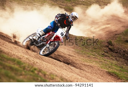 """ALMATY, KAZAKHSTAN - APRIL 10: P.Blinov(10) in action at Motocross competition """"Fabrichny Cup""""- Open Championship of Kazakhstan, on April 10, 2011 in Kargaly, Kazakhstan."""