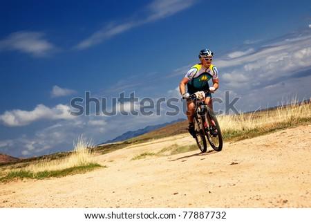 "ALMATY, KAZAKHSTAN - APRIL 30: R.Nurjanov (N24) in action at Adventure mountain bike cross-country marathon in mountains ""Jeyran Trophy 2011"" April 30, 2011 in Almaty, Kazakhstan."