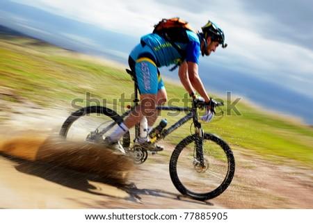 "ALMATY, KAZAKHSTAN - APRIL 30: T.Dauranov (N25) in action at Adventure mountain bike cross-country marathon in mountains ""Jeyran Trophy 2011"" April 30, 2011 in Almaty, Kazakhstan."