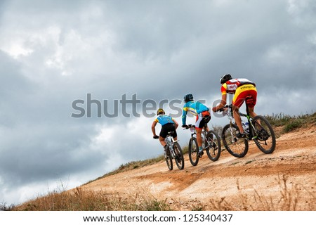 "ALMATY, KAZAKHSTAN - APRIL 30: Unidentified bikers in action at Adventure mountain bike cross-country marathon in mountains ""Jeyran Trophy 2011"" on April 30, 2011 in Almaty, Kazakhstan."