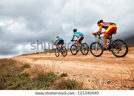 "ALMATY, KAZAKHSTAN - APRIL 30: Unidentified bikers in action at Adventure mountain bike cross-country marathon in mountains ""Jeyran Trophy 2011"" on April 30, 2011 in Almaty, Kazakhstan. - stock photo"