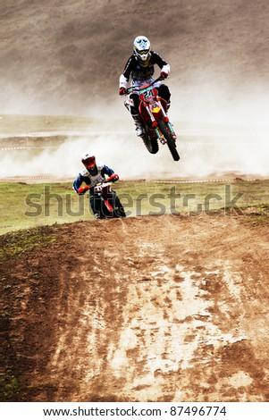 "ALMATY, KAZAKHSTAN - APRIL 10: V.Brikun(24) flies through the air at the Motocross competition ""Fabrichny Cup""- Open Championship of Kazakhstan on April 10, 2011 in Kargaly, Kazakhstan."