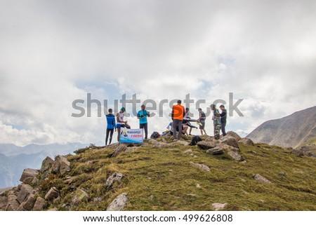 Almaty, Kazakhstan - August 20: Skyrunner runs in the mountains - Gorge Kim-Asar, Tien-Shan mountains, peak named Furmanova on August 20, 2016 in Almaty, Kazakhstan #499626808