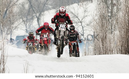 "ALMATY, KAZAKHSTAN - JANUARY 29: Racer E.Kadirov (N18) at Opening motocross season race at the track ""Sayran"" on January 29, 2012 in Almaty, Kazkahstan. - stock photo"