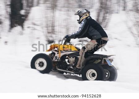 "ALMATY, KAZAKHSTAN - JANUARY 29: Unidentified motocross rider on quad bike (N99) at Opening motocross season race at the track ""Sayran"" on January 29, 2012 in Almaty, Kazkahstan."