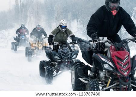 "ALMATY, KAZAKHSTAN - JANUARY 29: Unidentified motocross rider on quad bike Yamaha at Opening motocross season race at the track ""Sayran"" on January 29, 2012 in Almaty, Kazkahstan. - stock photo"