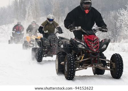 "ALMATY, KAZAKHSTAN - JANUARY 29: Unidentified motocross rider on quad bike Yamaha at Opening motocross season race at the track ""Sayran"" on January 29, 2012 in Almaty, Kazkahstan."
