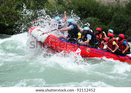 "ALMATY, KAZAKHSTAN - JUNE 27: ""Air Astana"" team in action at Rafting competition on Chilik river. June 27, 2011 in Almaty, Kazakhstan."
