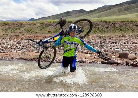 "ALMATY, KAZAKHSTAN - MAY 3: A.Kaspersky (N4) in action at Adventure mountain bike cross-country marathon in mountains ""Jeyran Trophy 2010"" May 3, 2010 in Almaty, Kazakhstan."
