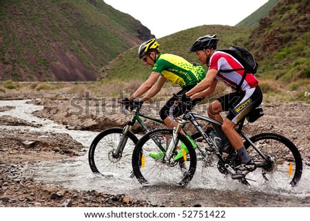 "ALMATY, KAZAKHSTAN - MAY 1: E.Janabaev (right) and M.Sheynikov in action at Adventure mountain bike cross-country marathon in mountains ""Jeyran Trophy 2010"" May 1, 2010 in Almaty, Kazakhstan."