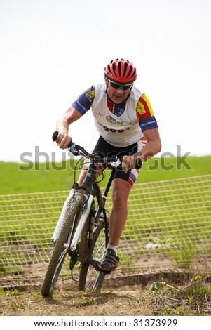 ALMATY, KAZAKHSTAN - MAY 23: Evgeny Kazantsev in action at cross-country mountain bike race Mercur Open Cup May 23, 2009 in Almaty, Kazakhstan.