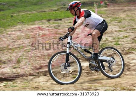 ALMATY, KAZAKHSTAN - MAY 23: Igor Baranov in action at cross-country mountain bike race Mercur Open Cup May 23, 2009 in Almaty, Kazakhstan.